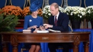 The Duke and Duchess of Cambridge sign the Canadian government's Golden Book at the Legislative Assembly in Victoria, B.C., on Saturday, September 24, 2016. (THE CANADIAN PRESS/Jonathan Hayward)