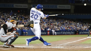 Toronto Blue Jays' Josh Donaldson watches his two run home run against the Baltimore Orioles during the first inning of MLB baseball action in Toronto, on Tuesday, Sept. 27, 2016. (Mark Blinch / THE CANADIAN PRESS)