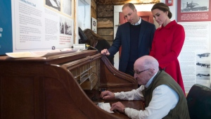The Duke and Duchess of Cambridge look on as Doug Bell sends a message at the MacBride Museum of Yukon History in Whitehorse, Yukon, Wednesday, Sept. 28, 2016. (Jonathan Hayward/The Canadian Press)