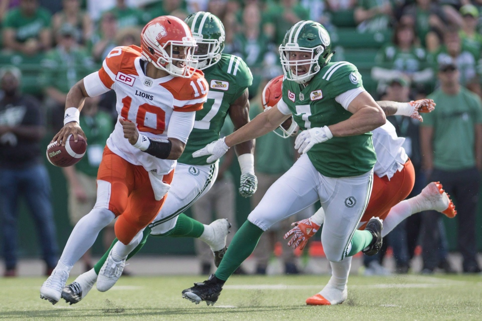 B.C. Lions quarterback Jonathon Jennings (#10) takes off with the ball under pressure from Saskatchewan Roughriders defensive lineman Justin Capicciotti (#7) during first half CFL action in Regina on Saturday, July 16, 2016. THE CANADIAN PRESS/Rick Elvin