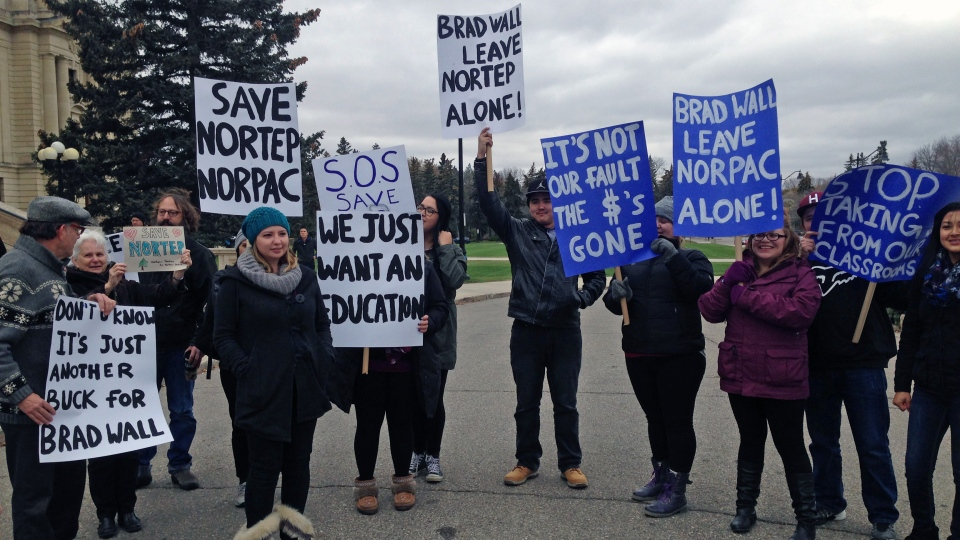 Protesters, rallying against provincial funding cuts to the Northern Teacher Education Program, hold signs outside the Saskatchewan Legislature on Wednesday, Oct. 19, 2016. (Jamie Fischer/CTV Regina)