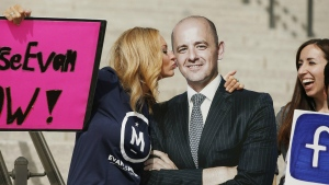 Brynnley Pyne pretends to kiss a cardboard cutout of Evan McMullin as McMullin supporters rally at the Utah State Capitol in Salt Lake City on Oct. 13, 2016. (Jeffrey D. Allred / The Deseret News)