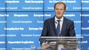 European Council President Donald Tusk addresses the media after the first day of an EU summit in Brussels early Friday, Oct. 21, 2016. (AP / Geert Vanden Wijngaert)