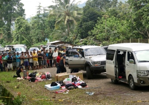 Residents watch as police inspect the contents of the vehicles following an operation Friday, Oct. 28, 2016 at Makilala township, North Cotabato province in southern Philippines. (AP Photo)