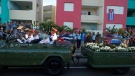 """The motorcade carrying the ashes of the late Cuban leader Fidel Castro makes i's final journey towards the Santa Ifigenia cemetery in Santiago, Cuba Sunday, Dec. 4, 2016. Thousands of people lined the short route from the Plaza Antonio Maceo or Plaza of the Revolution to the cemetery waving Cuban flags and shouting """"I am Fidel!"""".(AP Photo/Dario Lopez-Mills)"""