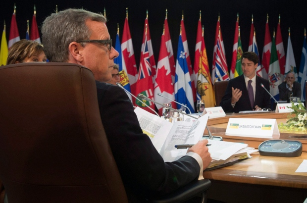 Saskatchewan Premier Brad Wall looks around as Prime Minister Justin Trudeau delivers his remarks for the afternoon session at the First Ministers' Meeting in Ottawa, Friday, December 9, 2016. THE CANADIAN PRESS/Adrian Wyld
