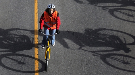 A woman takes part part in a mass bicycle ride of approximately 500 people organized by the Dutch near the Richmond Olympic Oval in Richmond, B.C., on Saturday, Feb. 6, 2010. (Darryl Dyck / THE CANADIAN PRESS)