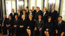 Saskatchewan Premier Brad Wall poses for a photo with his newly shuffled cabinet Friday at Government House in Regina.