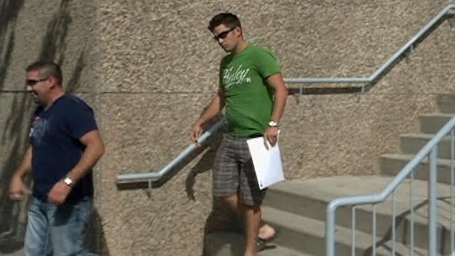 Nelson Menard, right, is seen leaving the Regina provincial courthouse on Sept. 13.